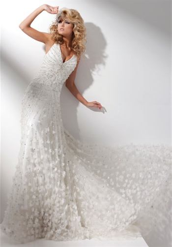Gown features beading and feathered tulle petals.