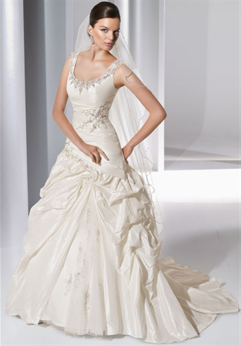 Gown features asymmetric-waist and beading.